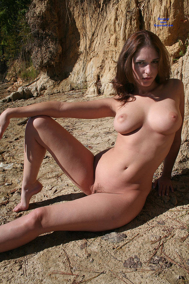 Nude brunette outdoors naked