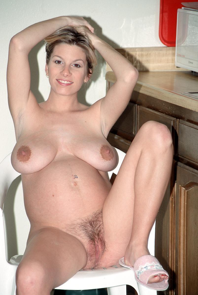 Pregnant nude kitchen