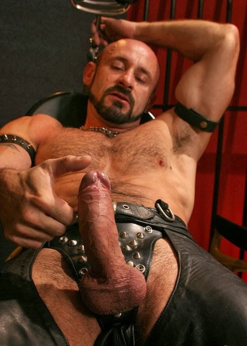 man naked in leather chaps