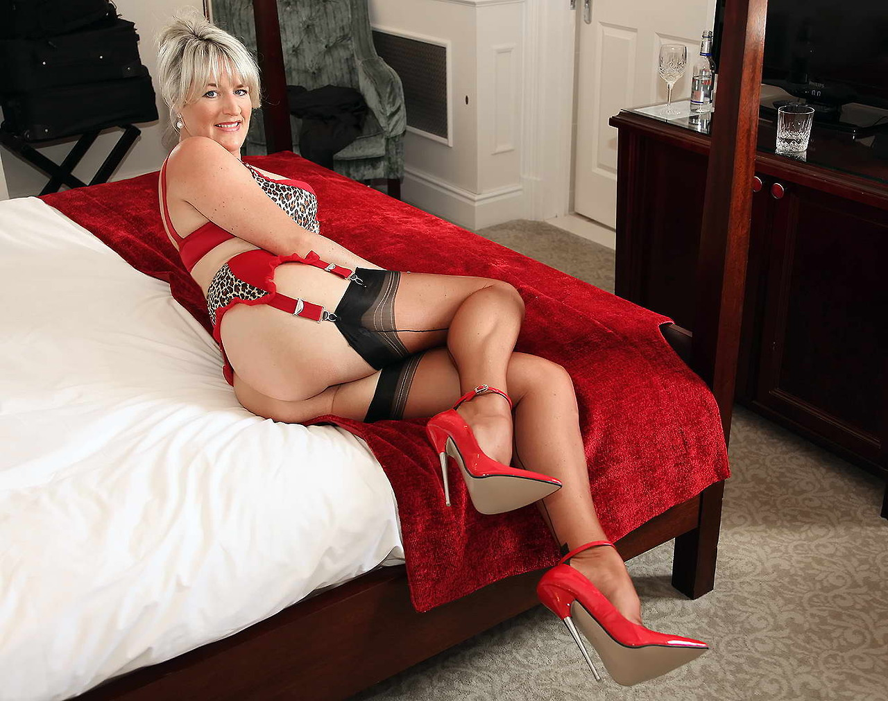 With Red high heels and stockings porn images for