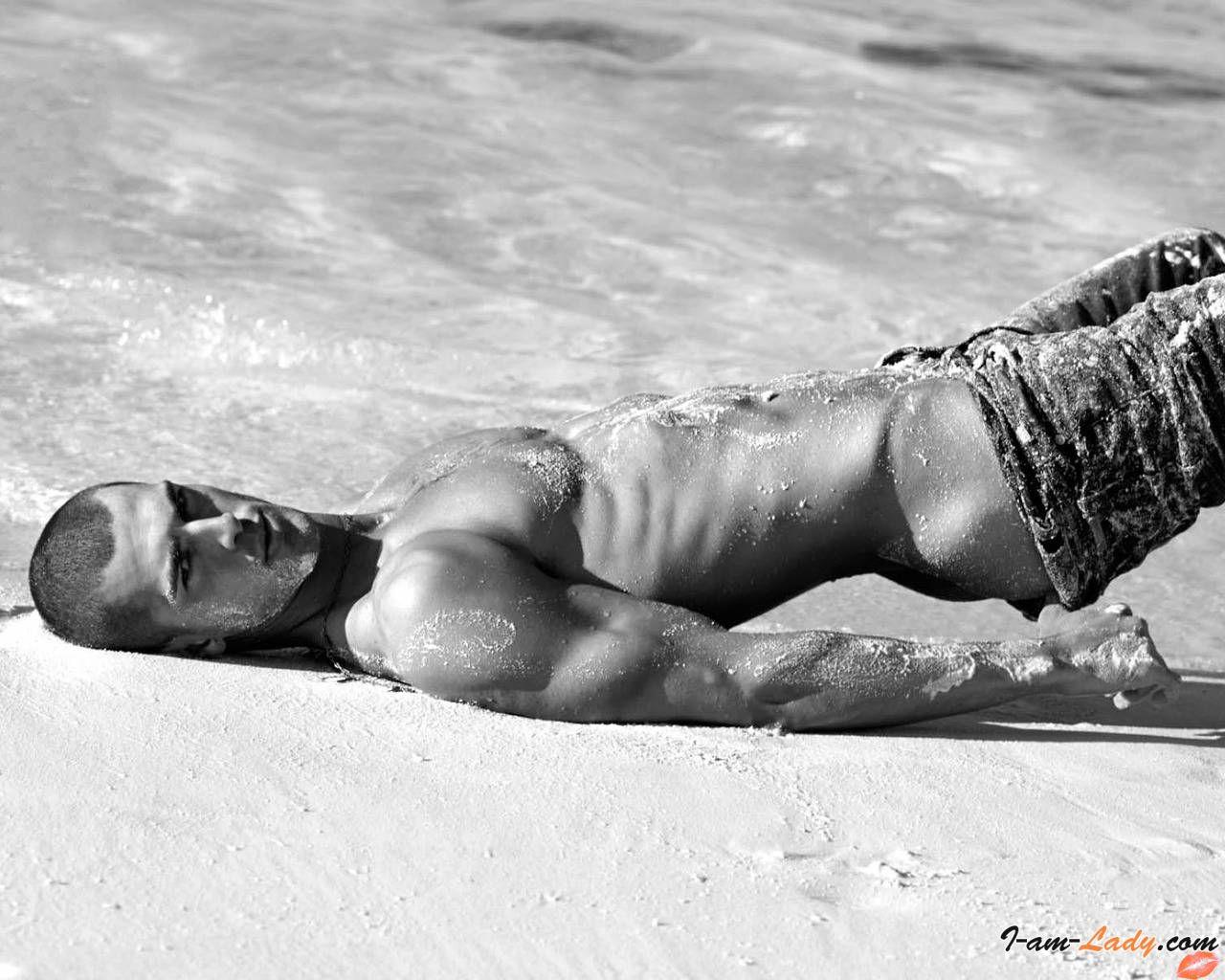 Male butt crack beach