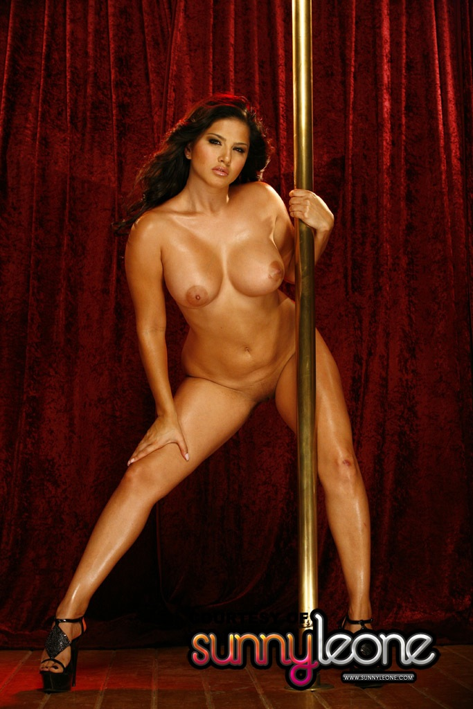 Dancing naked pole dancer