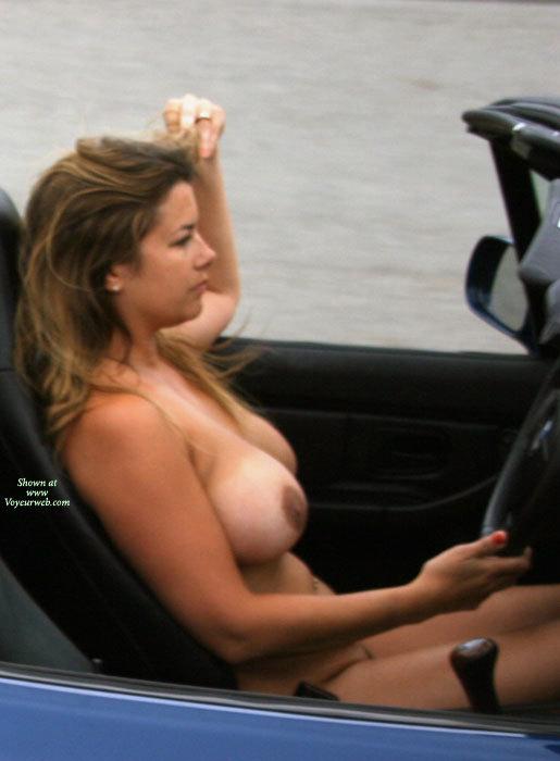 Naked girl driving bmw