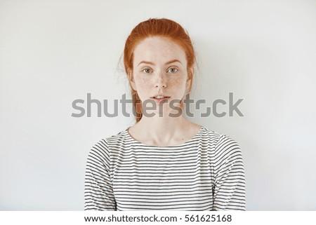 Shy redhead teen