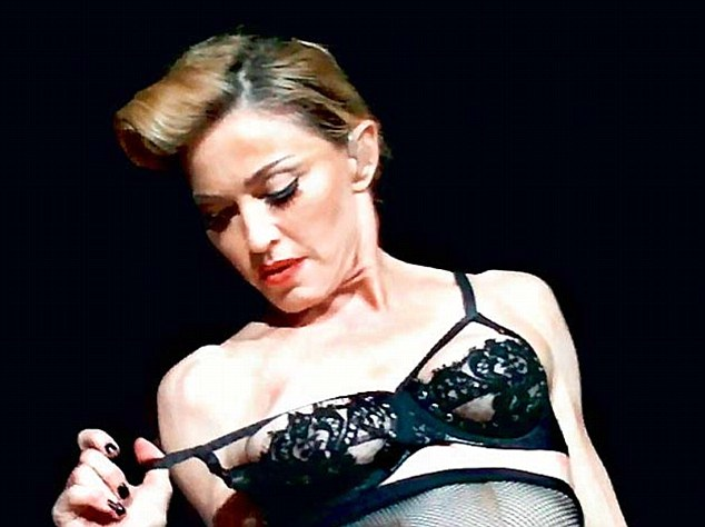 stage Madonna topless on