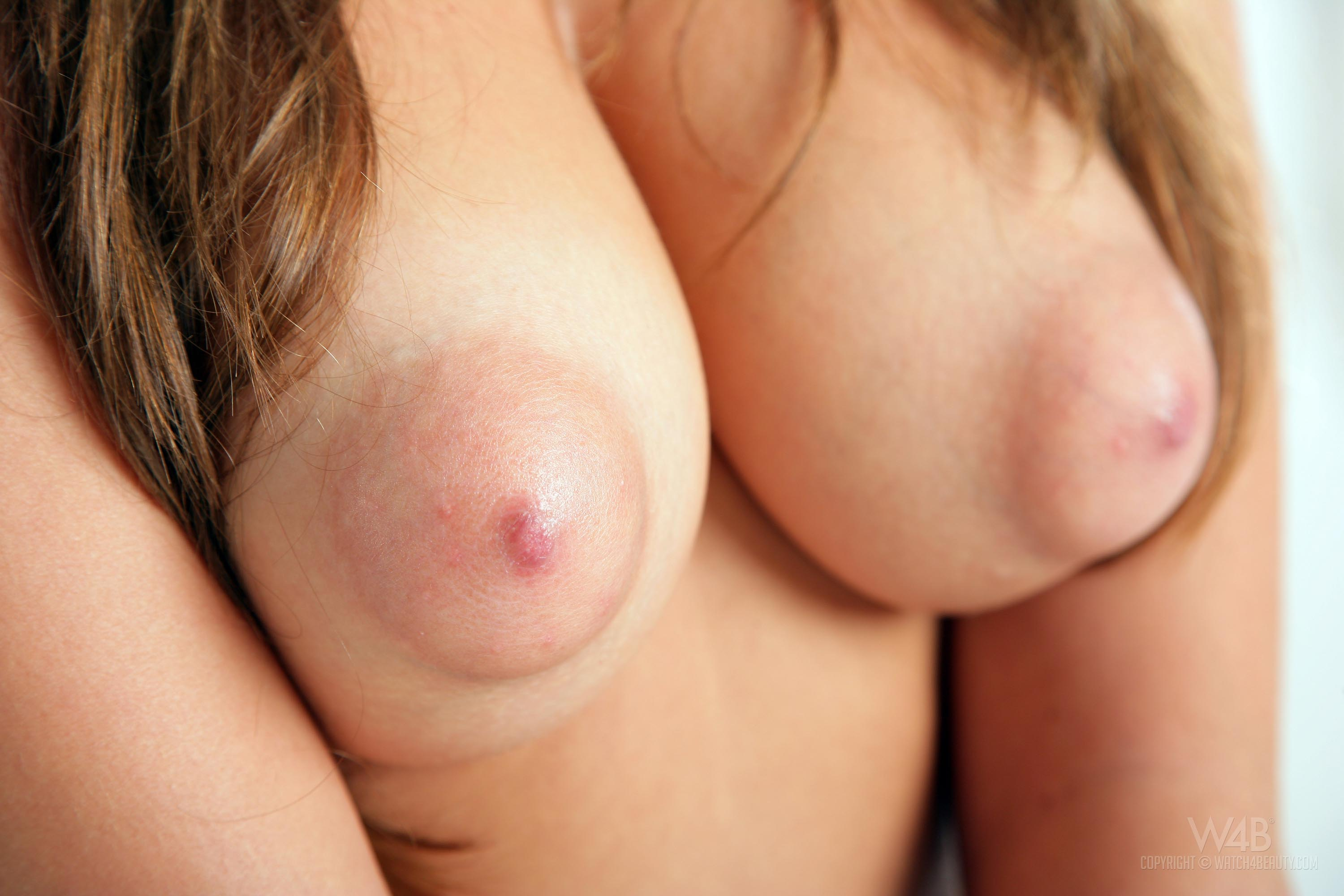 Big puffy tits nipples close up