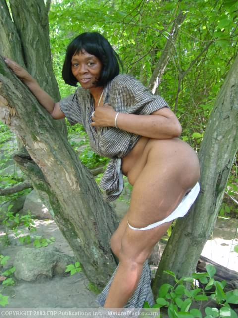 Old black granny nude outdoors
