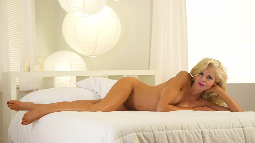 Beautiful nude blonde women on beds