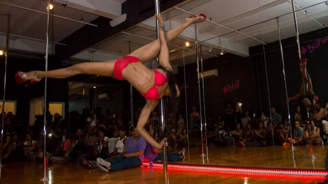 Girl on stripper pole