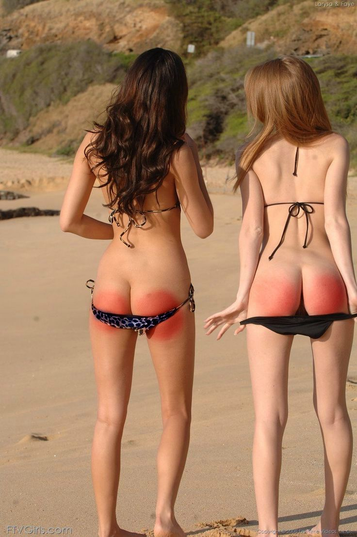 Girls getting a spanking on the beach
