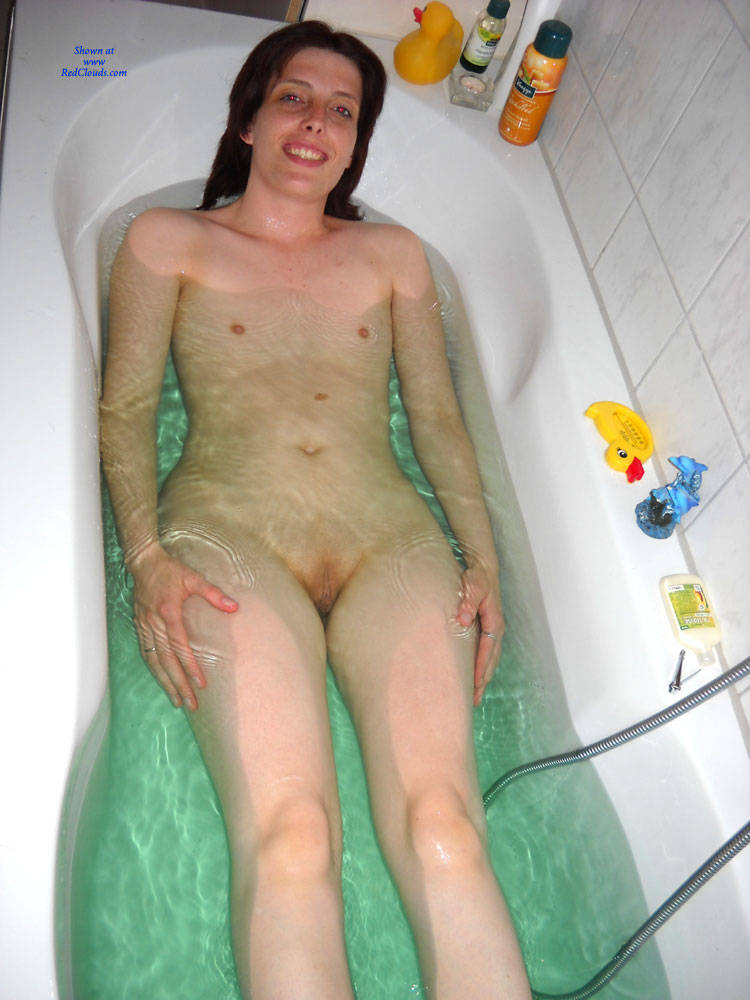 Nude girl bath tub