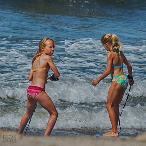 Candid teens in bikinis at the beach