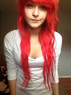 Scene girl with red hair and piercings