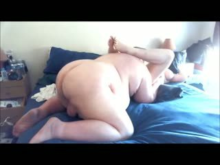 Wife lying naked on bed