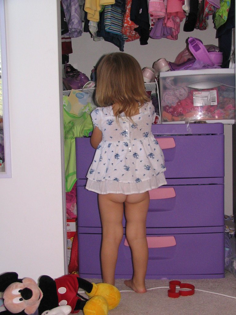Girl butt naked toddler playing