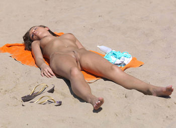 Nude sunbathing beach girl