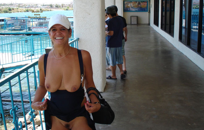 Mature amateur wife flashing pussy in public