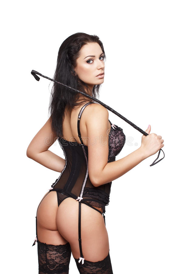 Brunette with whip posing