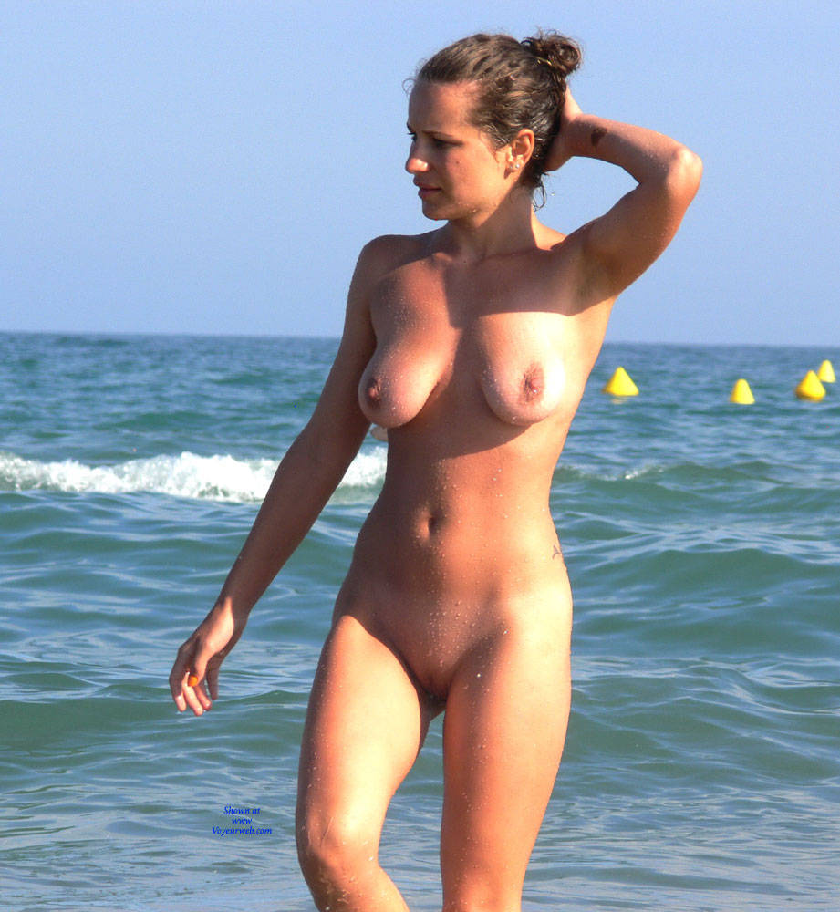 Walking naked at the beach
