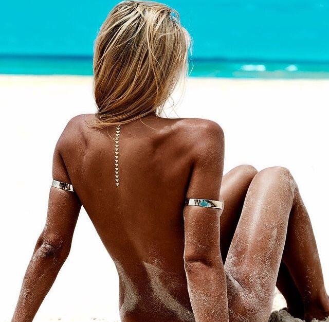 Nude girls playing in ocean beach