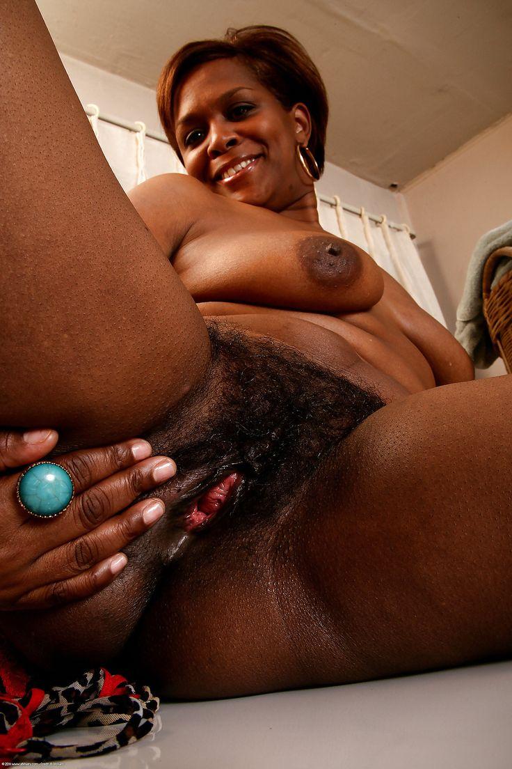 Dark black ebony hairy pussy