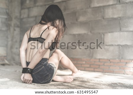 Girl tied up with rope
