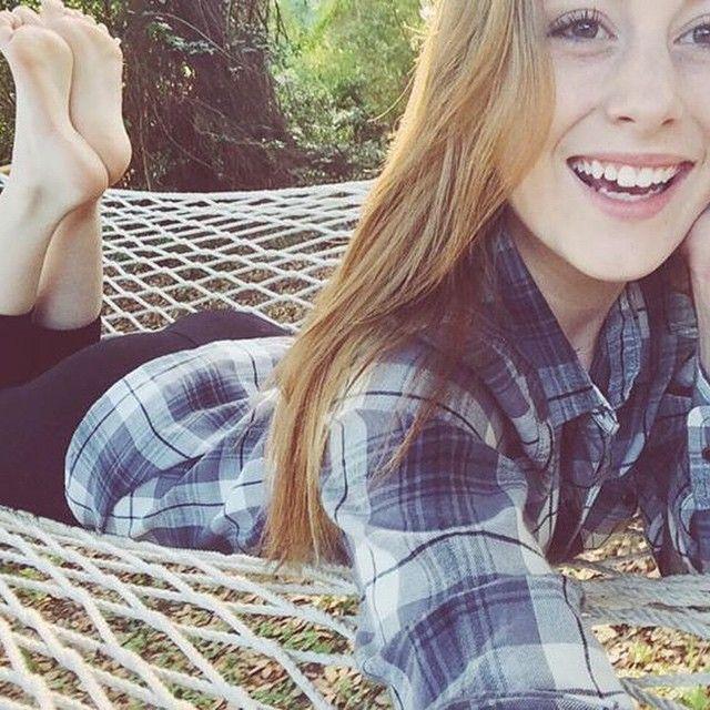 Blonde teen soles of feet