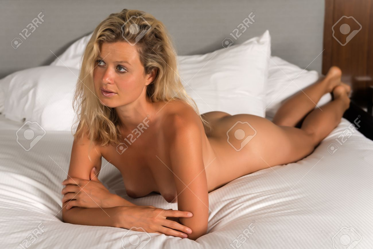 Nude women on beds