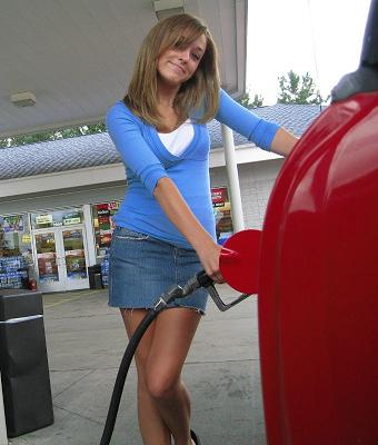 Girls pumping gas
