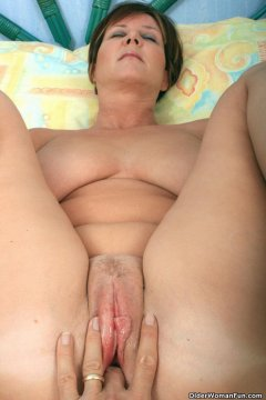 Older woman getting naked
