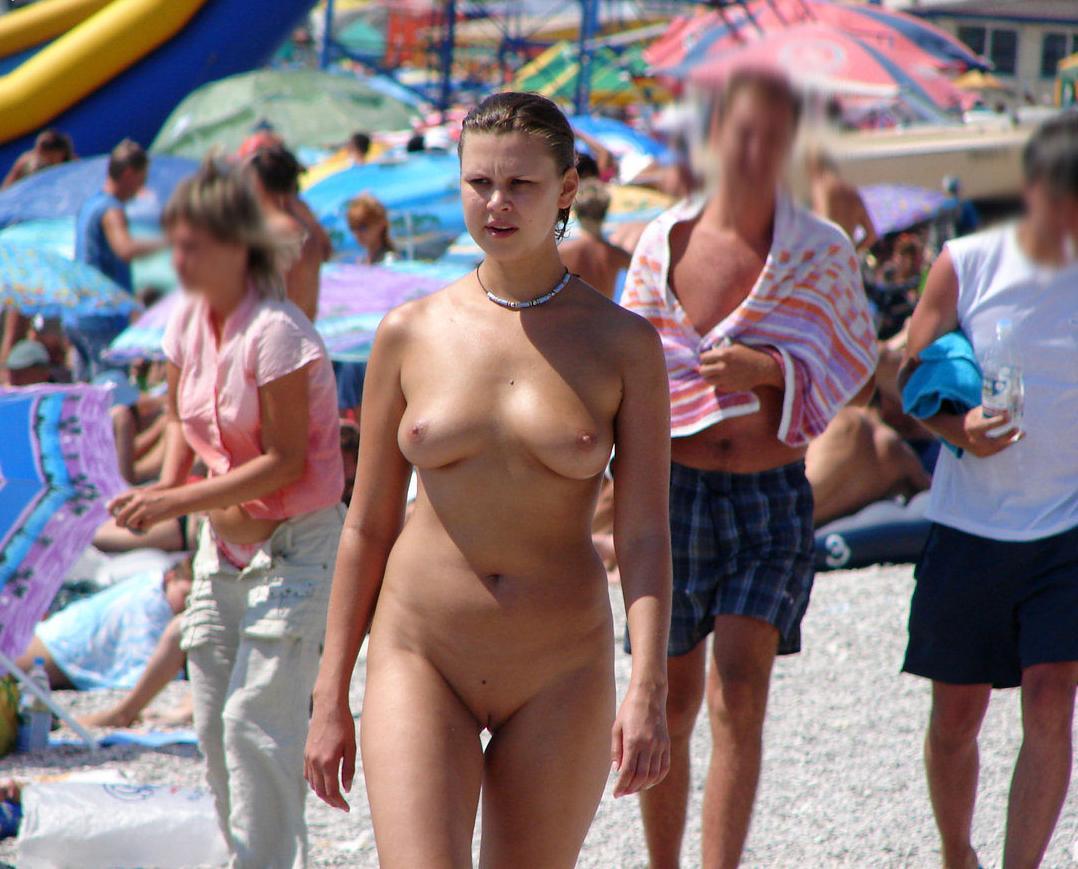 Walking naked at the beach
